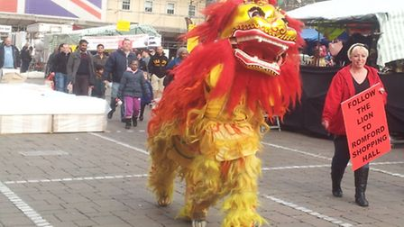 The dragon wasn't alone - a traditional Chinese lion also paraded through the market on Saturday, le