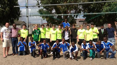 Bower Park Academy pupils with pupils in Vuyani during a football coaching trip