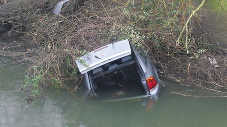 The car was left partially submerged in the River Roding.