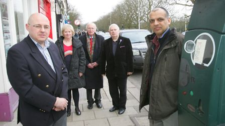 Council leader Keith Prince and bookshop owner Tan Dhillon