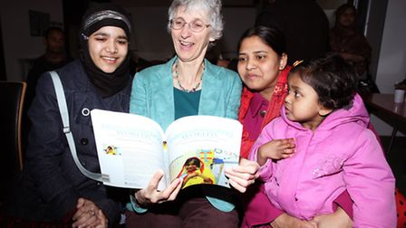 "Anwara Sabera, left, and Mohana Ahmed, left, learn about bilingualism issues through the book ""Inter"