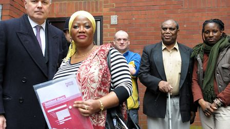 MP Iain Duncan Smith (left) with residents of Chartwell Court including Natasha Lewis (right)