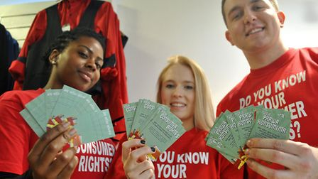 Students Rebecca Luke and Laura Smith, both 18, and student liaison officer Liam Davis with the mone