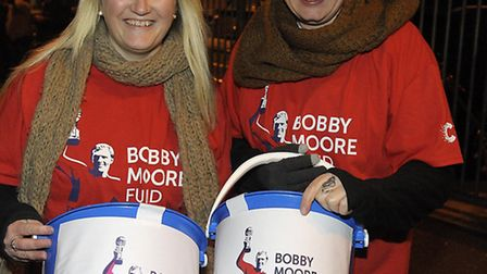 Two women collect donations from fans around the Boleyn Ground, Upton Park.