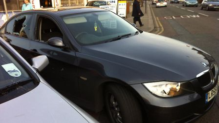 The was driving this black BMW when he failed to stop for police.