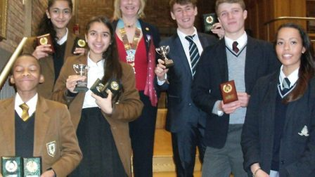 The teams from Chigwell School and Beal High School with their trophies and Rotary London District G