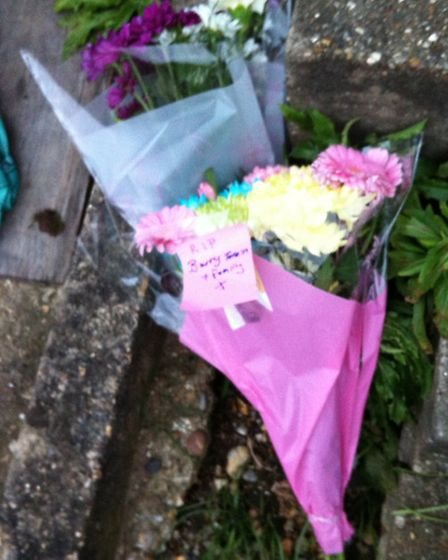 Tributes outside the couples home in Greenwood Gardens.