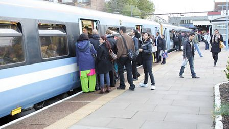 Commuters on the platform at Seven Kings station