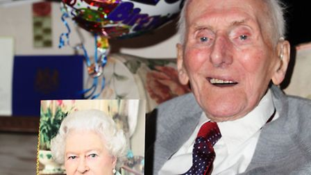 Ernest Fenn shows off the birthday card he received from the Queen to mark his 100th birthday.