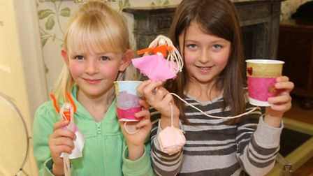 Chloe Keegan and Maize Barmer with their Victorian toys