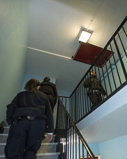 Officers checking a tower block after a request from residents. Picture: Justin Setterfield