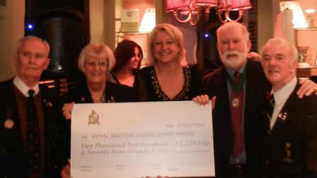 Harrow pub manager Sarah Jefferies presents the cheque to members of the Hornchurch Royal British Le