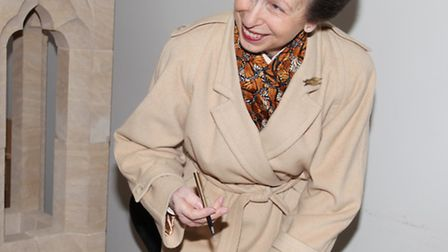 Princess Anne signs the guest book of the Building Crafts College in Stratford.