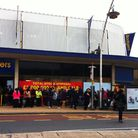People are queuing around the block for a bargain. Photo: Richard Barker