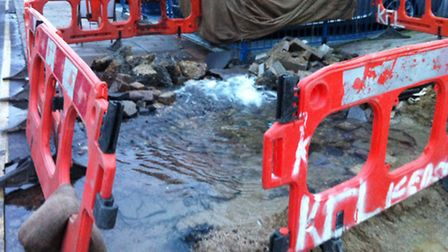The burst water main has filled a crater in Ilford High Road.