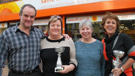 Celebrations at the Romford South Street Saint Francis Hospice shop: From L to R: Steve Rose, Shops