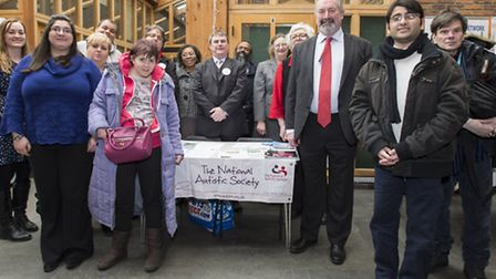 Newham's executive member for health, Cllr Clive Furness, third left, and residents gather at the au