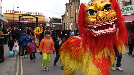 Children join a Chinese New Year celebration outside East Ham Market Hall.Picture: Isabel Infantes