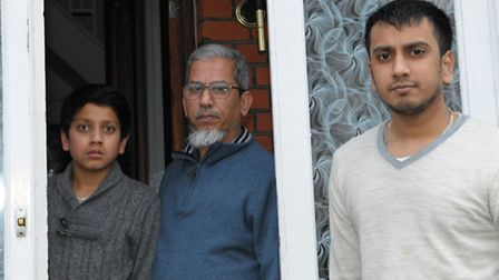 Syed Ahmed, right, with his father, Syed, and younger brother, Syed Mushrat, 12