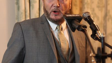 Bradford West MP George Galloway gives a speech as the guest speaker in a Newham People Alliance mee