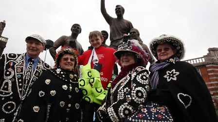 Jonjo Heuerman, 11, celebrates with Pearly King and Queens as he completes his walk back to West Ha
