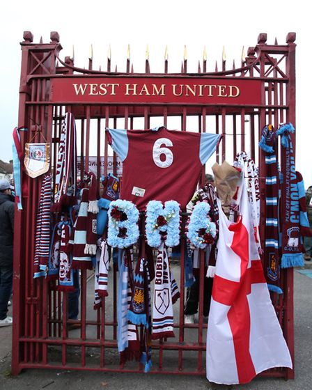 A memorial tribute to Bobby Moore outside West Ham United Stadium on the 20th anniversary of his de