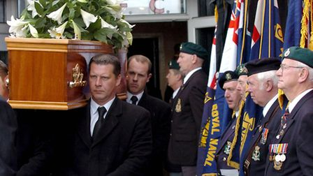 The coffin of Ron Todd is carried from Dagenham and Redbridge's football ground after his funeral se