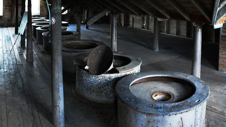 Panoramic view of the bottom floor of The House Mill, a Grade I listed 18th century tidal mill in Th