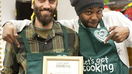 Let's Get Cooking club coordinator Ralph and club member Leon celebrate winning their Golden Spoon a