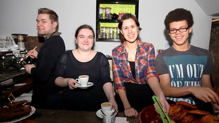 Tom Gray, left, manager Hettie Clarke, Asha Stokes, and Elliot Francis Hewett behind the counter at