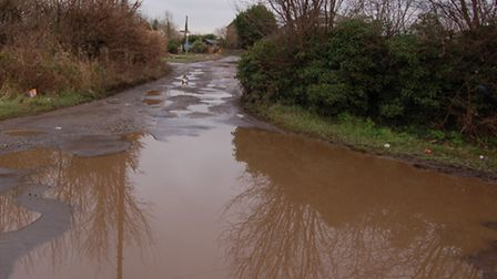 The entrance to bridle way 93 from Oaks Lane with huge puddles in winter