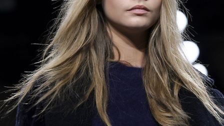British model Cara Delevingne wearing a design from the Unique collection during London Fashion Week