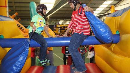 Gladiator style fighting in the inflatable play area