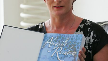 Nicola Simpson with a draft copy of her book Abigail's Rainbow she wrote in memory of her daughter