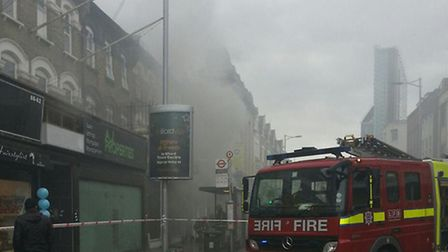Smoke pouring out of the PDSA charity shop in Ilford. Picture: Simon North