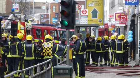 The fire quickly spread once it took hold inside the PDSA charity shop. Picture: David Martin