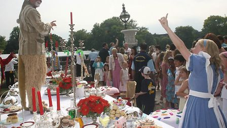 A Mad Hatter's Tea party gets into full swing.