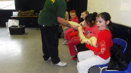 Students hold a boa constrictor to mark National Science and Engineering week