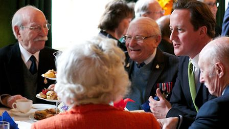 Maurice Conway (left) and Leslie Temple (centre) share a joke with Prime Minister David Cameron