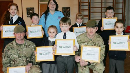 Brady Primary School children and soldiers with their awards