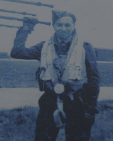 Maurice, aged 19, at 1st Squadron base in Tholthorpe, Yorkshire next to a Halifax Bomber