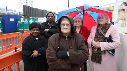 Lilian Bruton (centre), and her neighbours from Victoria Dock Road, are angry about the inconvenienc