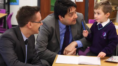 Labour MP Stephen Twigg together with teacher James Dawson, left, talk to five-year-old Liam Girling