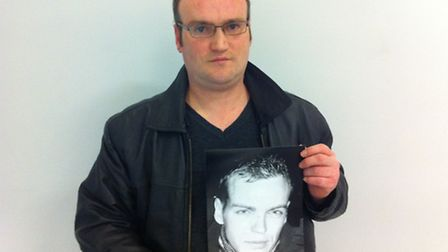 Marius Svolkinas holds a picture of his older brother