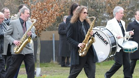 Musicians playing at Kenny's funeral