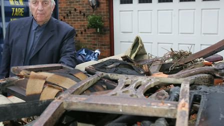 Alby Tebbutt with some of his fire-damaged furniture