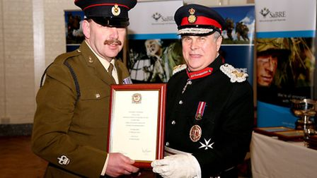 Warrant officer Keith Smith (left) and Sir David Brewer
