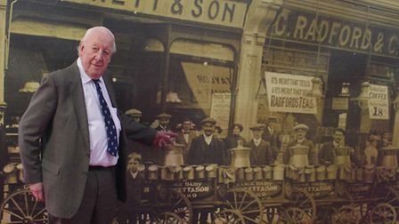 Hugh Peskett points to his grandfather Ernest Peskett in a photo taken in Cranbrook Road, Ilford, an