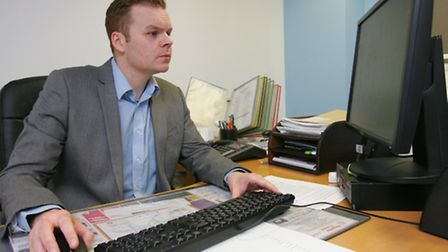 Ben Collins at work in his office