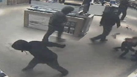The gang stealing phones from Carphone Warehouse in Charlton Barking. Picture: Metropolitan Police/P